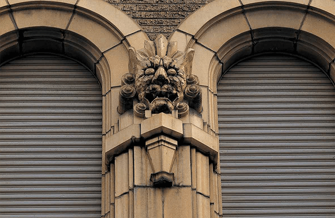 A terracotta ornament of Oni (demons) produced by Ina Seito (INAX), adorning the wall of the former headquarters of Dainippon Pharmaceutical, built in 1930. In Japan, Oni  were thought to ward off evil spirit and protect those inside.