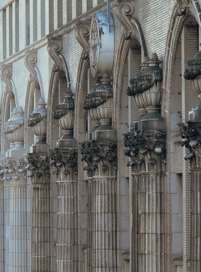 Terracotta decoration of elaborate vases on top of a series of fluted Corinthian pilasters with acanthus capitals produced by Ina Seito (INAX) for the Takashimaya Osaka department store building, built in 1932.